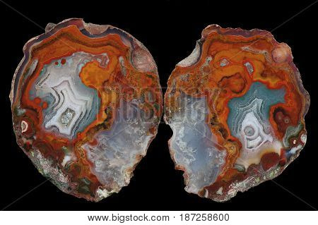 A cross section of the agate stone. At the bottom is a gray-blue pseudomorphosis. Multicolored silica rings colored with metal oxides are visible. Origin: Asni Atlas Mountains Morocco.