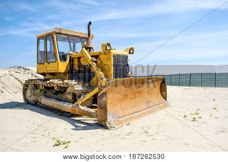 Ferrara italy May 14 2017 - A crawler Caterpillar bulldozer used to push sand on the beach
