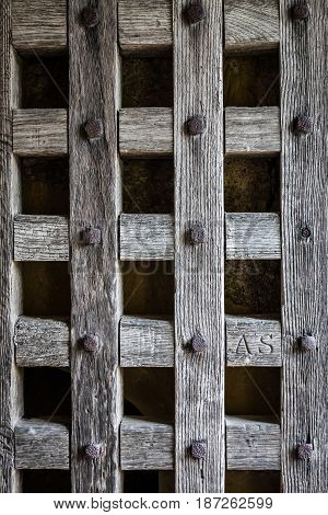 Background of an ancient castle wooden door with nails and little square shapes