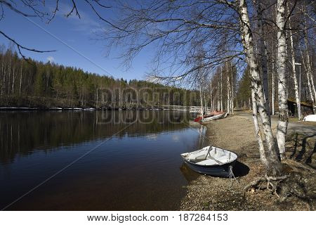 Spring day with blue sky and calm water on