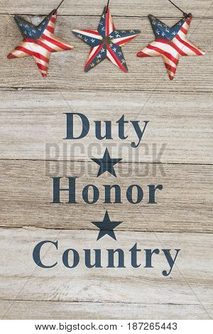 Duty Honor and Country message USA patriotic old flag on a stars a weathered wood background with text Duty Honor Country