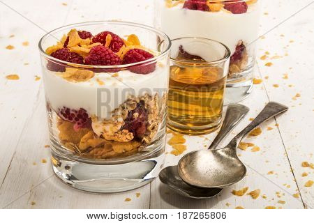 cranachan a very scottish dessert made with corn flakes raspberries whisky and whipped cream in a glass