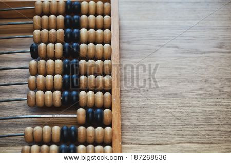 old abacus on the vintage wooden table. free space. Place for text