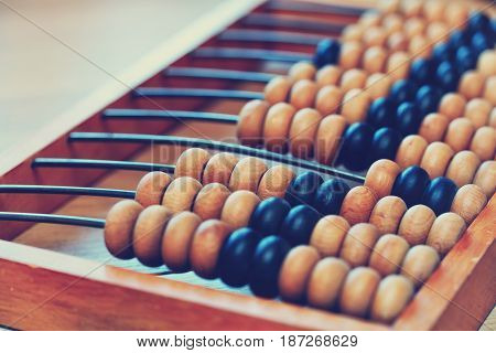 old wooden abacus close-up. Old Style Photo