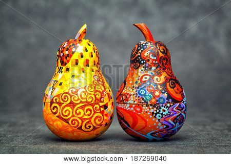 the pears are made of wood and painted colors manually. single-piece art