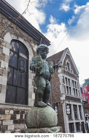 Bronze Sculpture Of A Boy Holding Two Fishes At Fischmarkt In Aachen