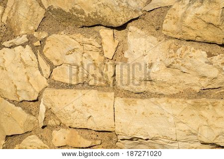 Stone wall of one of the buildings on the excavations (Israel)