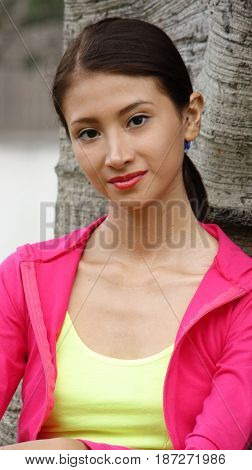 Hispanic Pretty Person Wearing Pink and Yellow