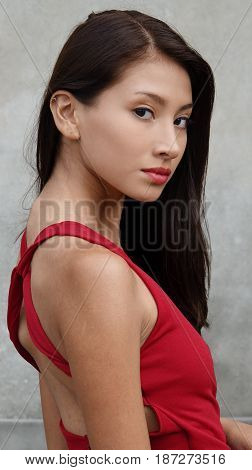 Slender Girl Teen and Wearing a Red Dress