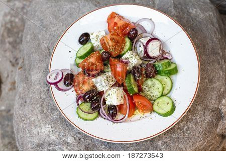 Greek salad with tomatoes cucumbers feta red onions olives