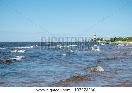 baltic sea shore with waves and lighthouse