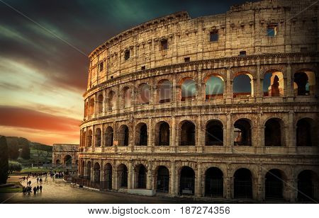 Rome, Italy. One of the most popular travel places in world - Roman Coliseum under evening sun light or sunrise sky.