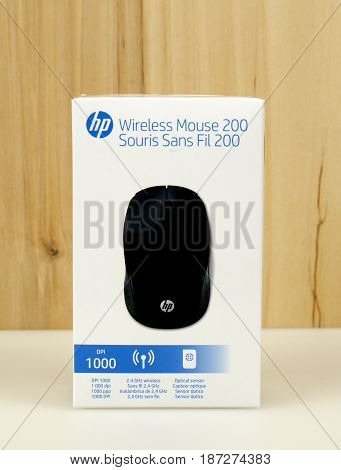 RIVER FALLS,WISCONSIN-MAY 19,2017: A hp brand wireless mouse with a wood background.
