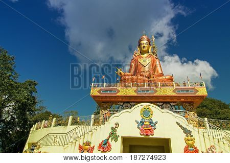 Samdruptse statue a huge buddhist memorial statue in Sikkim blue cloudy sky in background. It is a favourite tourist spot in Sikkim.