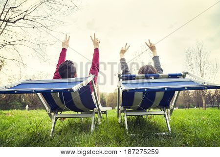 Nice Couple Relaxes And Enjoys Putting Their Hands Up