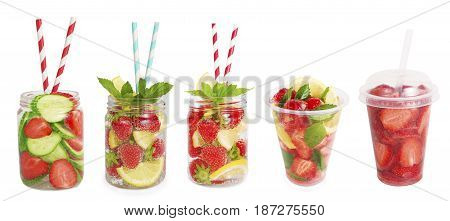 Drinks from strawberries blueberries orange cucumber. Collage of lemonades isolated on white background. Set of different refreshing drink with striped straw. Drinks in a glass jar.