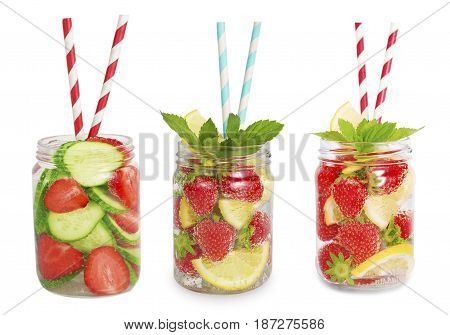 Drinks from strawberries lemon cucumber. Collage of lemonades isolated on white background. Set of different refreshing drink with striped straw. Drinks in a glass jar.