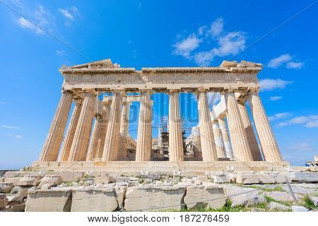 facade of Parthenon temple over bright blue sky background, Acropolis hill, Athens Greece