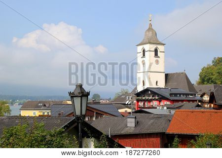 Travel To Sankt-wolfgang, Austria. The View In The Buildings And A Lantern On The Mountains City.