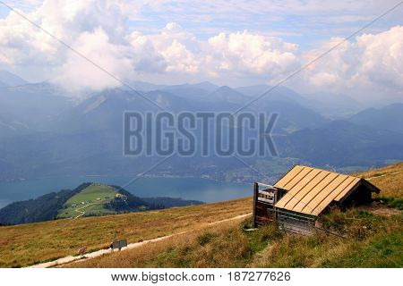 Travel To Sankt-wolfgang, Austria. The Green Meadow With The House In The Mountains.