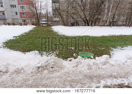 Nizhny Novgorod Russia. - November 28.2016. Above the underground pipe with the hot water melted snow