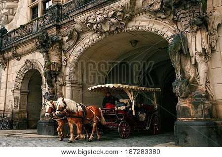 Dresden, Germany, December 19, 2016: A trip in a carriage with horses. Entertainment of tourists in Dresden. Europe