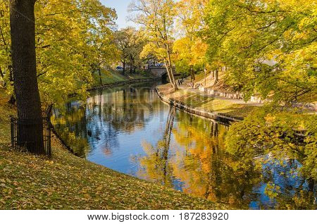 Beautiful autumn park at the channel in Riga