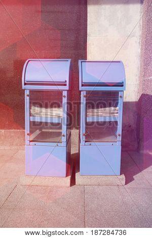 Blue newspaper dispensers on sidewalk; Tallinn; Estonia; Europe