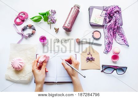 Beauty Blog Concept. Lilac Colour. Female Hands Writing In Notebook Among Styled Accessories: Sungla