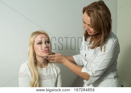 Beautiful young girl on examination with a doctor in a polyclinic