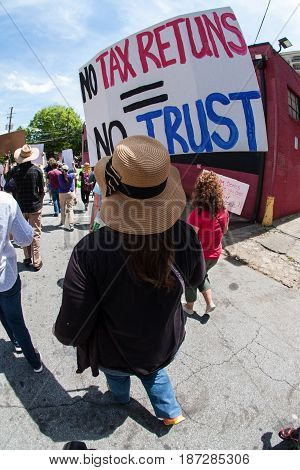 ATLANTA, GA - APRIL 2017:  A woman holds sign that says