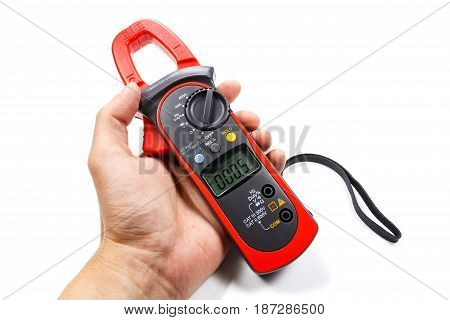 Digital Clamp Multimeter In Man's Hand On A White Background