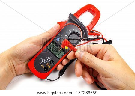 Digital Clamp Multimeter With Probes In Man's Hand On A White Background