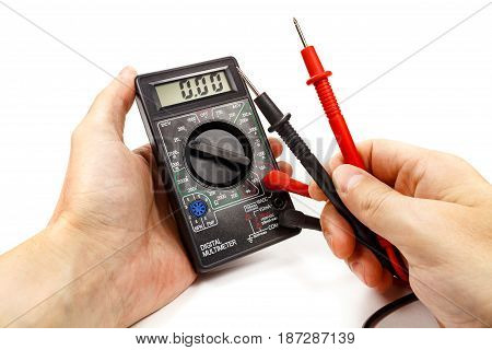 Digital Multimeter With Probes In Man's Hand On A White Background