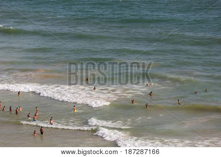 ALBUFEIRA, PORTUGAL - AUGUST 25, 2016: People at the beach of Olhos de Agua in Albufeira. This beach is a part of famous tourist region of Algarve.