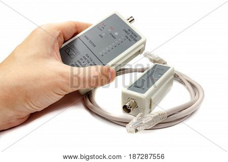 Network Cable Tester In Man's Hand And Remote Probe With Utp Cable On A White Background