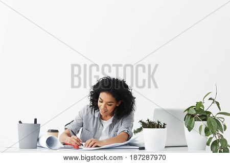 Portrait Of Dark-skinned Beautiful Businesswoman Dressed In Shirt Being Busy At Her Workplace While