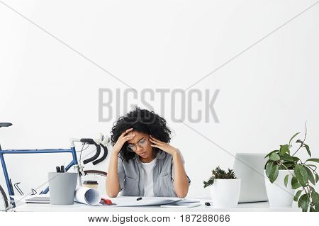 Confused Concentrated Mixed Race Woman Dressed Formally Wearing Big Round Eyeglasses Being Focused O