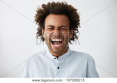 Feeling So Angry! Studio Shot Of Stressed And Furious African American Businessman In Shirt Shouting