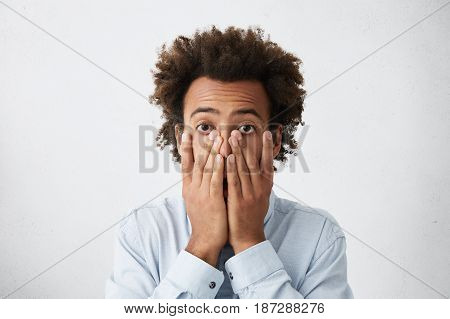 Oh No. Worried Afro American Businessman Covering Face With Both Hands, Feeling Stressed Out After H