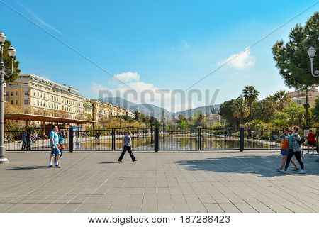 People Walking And Relaxing At Promenade Du Paillon