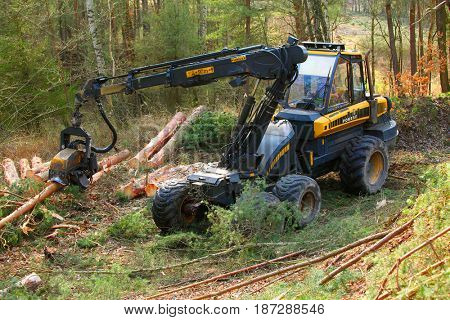 PILSEN CZECH REPUBLIC - APRIL 5, 2017: unidentified lumberjack with modern harvester Ponsse Ergo 6W working in a forest. Forestry is Czech's traditional industry with a very long history.
