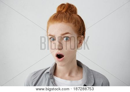 Oh My God! Funny Astonished Young European Female With Ginger Hair And Freckles Opening Mouth Widely