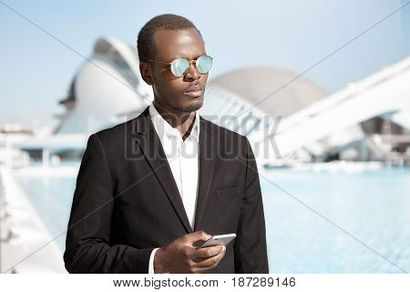 People, Business, Technology Concept. Young Elegant Handsome Dark-skinned Manager Of Company Dressed