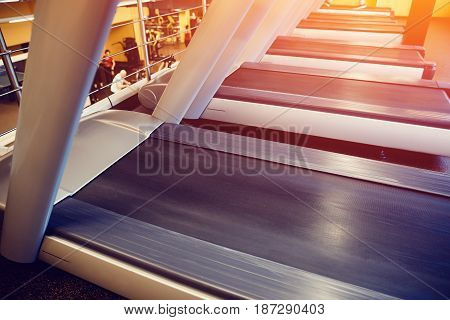 Treadmill close-up. Concept running at home, sports uniform.high contrast and monochrome color tone.