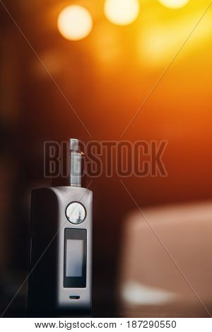 Close-up of electronic cigarette. vaping device. steam generator. high contrast and monochrome color tone.