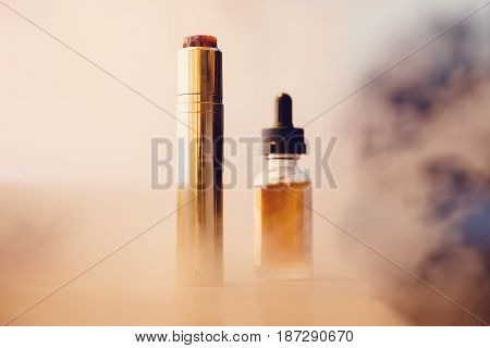 Electronic cigarette for vape with a battery in a club of smoke. Concept of giving up tobacco. Steam
