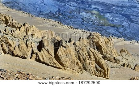Canyon To The High Mountains: To The Fore The Yellow Sandy Mountainside With Stone Idols And Behind