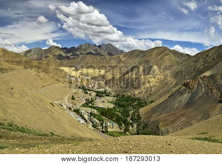 Mountain Village Lamayuru In Ladakh: Among The Yellow High Mountains There Green Fields, Trees And W