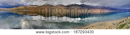 Panorama Of A Thunderous Evening At The High Mountains Of Lake Tso Moriri: Perfectly Flat Water Surf